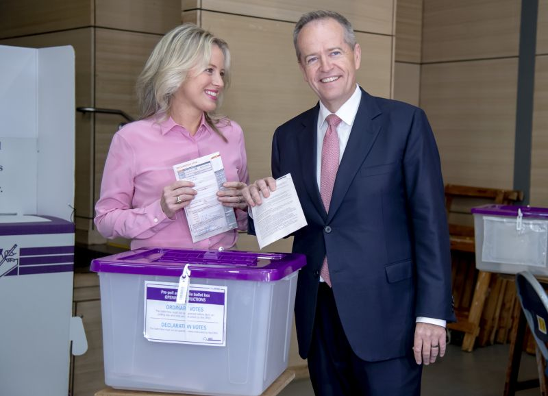 Australian opposition leader Bill Shorten poses as he votes with his wife Chloe during a federal election at Moonee Ponds West Primary School in Melbourne, Australia, Saturday, May 18, 2019.Polling stations opened across Australia on Saturday in elections that are likely to deliver the nation's sixth prime minister in as many years. (AP Photo/Andy Brownbill)