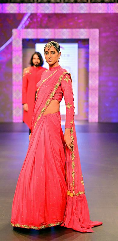 A model walking the ramp wearing one of Rachna's creation at Mysore Fashion Week