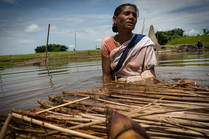 Without the manual effort of ASHA Abaron Bibi, the raft cannot move. She wades through the waters, tugging the raft across the wetland all by herself in an extremely hot and humid condition. (Photo: MoHFW)