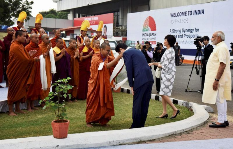 A group of Buddhist monks were also present to welcome Japanese PM Shinzo Abe. (Photo: PTI)