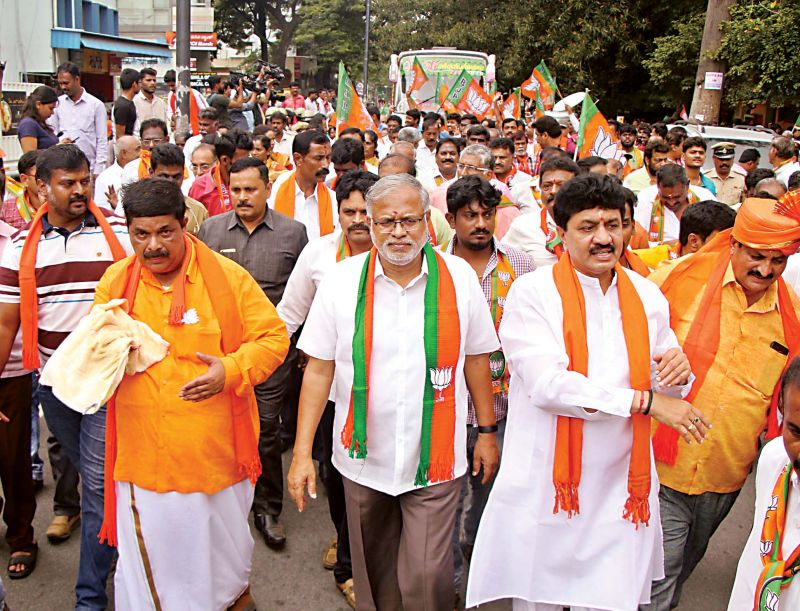 BJP's Gopalaiah accompanied by Minister Suresh Kumar and party workers go in a procession to file his papers for Mahalakshmi Layout seat.