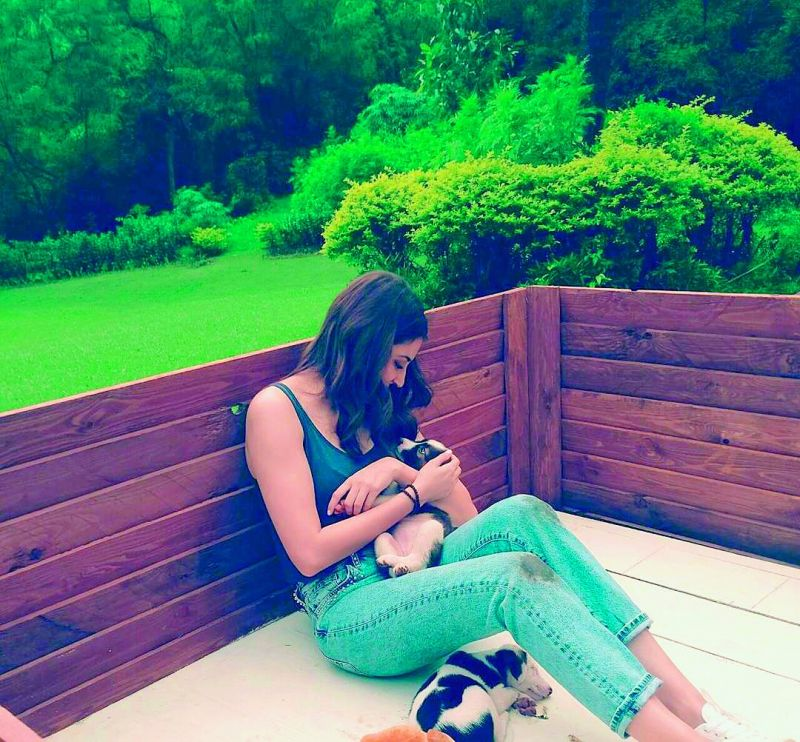 Anushka Sharma playing with her pet