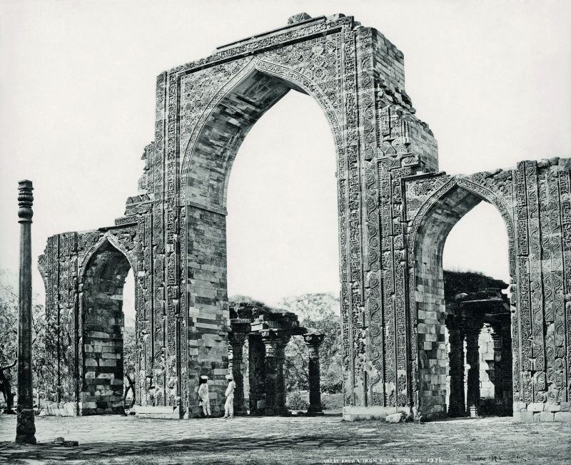 Delhi, The Great Arch and the Iron Pillar at the Qutub Minar.