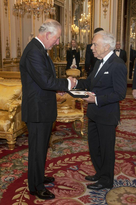 The Prince of Wales presents designer Ralph Lauren with his honorary KBE