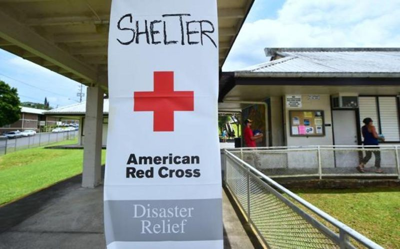 Evacuees carry supplies offered at the Pahoa Community Center in Pahoa on Hawaii's Big Island. (Photo: AFP)