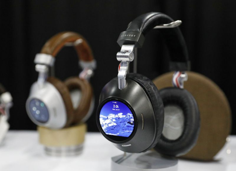 The Prelude smart headphones are on display at the Debussy Audio booth at CES Unveiled during CES International, Sunday, Jan. 6, 2019, in Las Vegas. The standalone device can stream high fidelity music and is compatible with several streaming services. (AP Photo/John Locher)