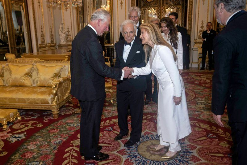 The Prince of Wales, designer Ralph Lauren, center, and his wife Ricky Lauren after he was presented with his honorary KBE (Knight Commander of the Order of the British Empire) for Services to Fashion in a private ceremony at Buckingham Palace. (Photo: AP)