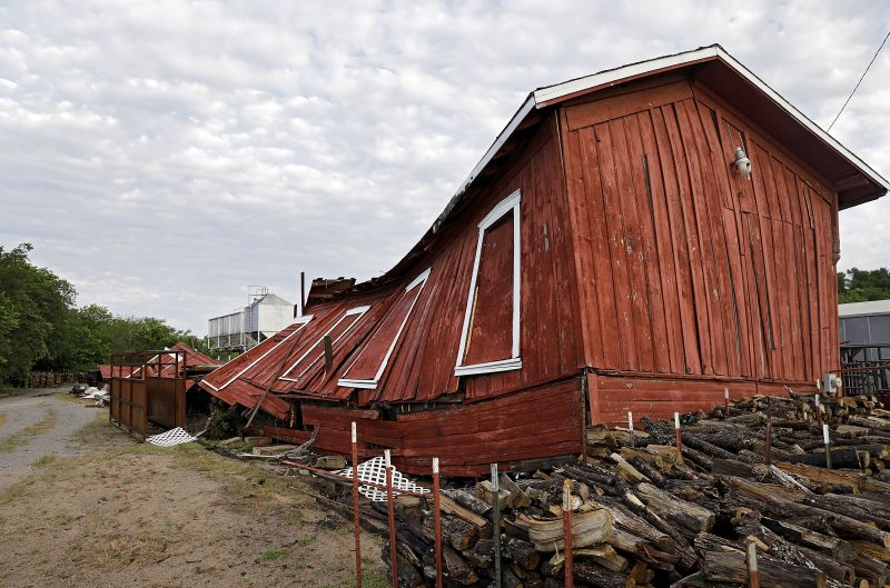 An historic railroad building owned by Farmers Feed Store was destroyed by a suspected tornado which hit Sapulpa, Okla., early Sunday, May 26, 2019. Farmers Feed Store uses the building, which has been there since at least the early 1900s, for storage. (Mike Simons/Tulsa World via AP)