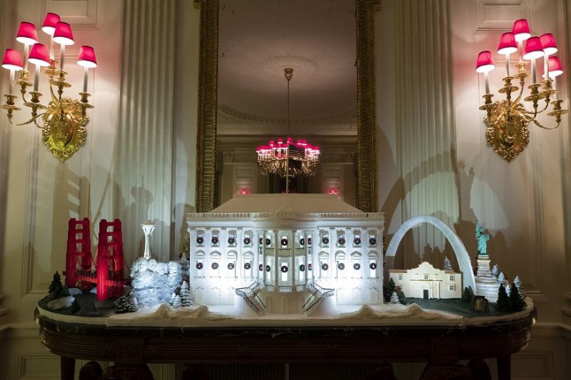 The White House made of gingerbread also features landmarks from around the country in the State Dinning Room during the 2019 Christmas preview at the White House in Washington. (Photo: AP)
