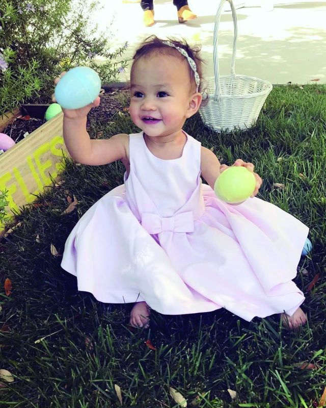 John Legend and Chrissy Teigen's daughter Luna plays with Easter eggs