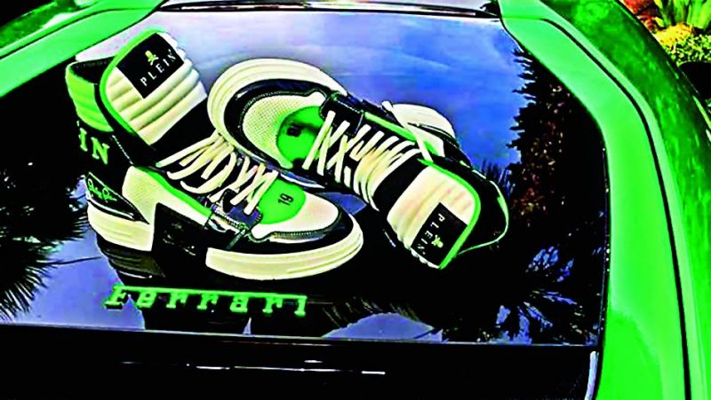 Italian luxury car manufacturer Ferrari has threatened to sue German fashion designer Philipp Plein for tarnishing their reputation after his Insta account showed images of his sneakers placed on the hood of his personal supercar.