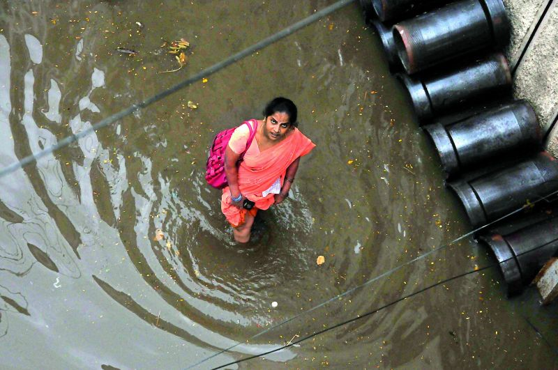 A woman walks through water in Malakpet. (Photo: DC)