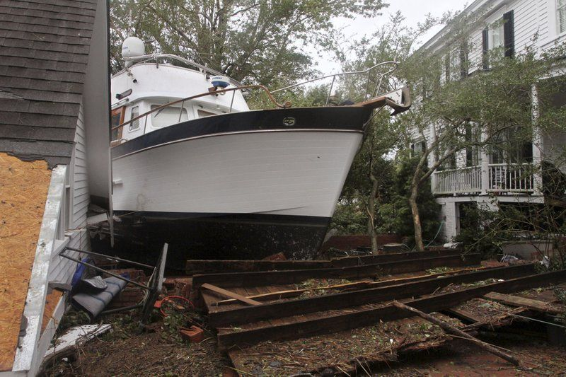 A 40-foot yacht lies in the yard of a storm-damaged home on East Front Street in New Bern, North Carolina on Saturday, September 15, 2018. The boat washed up with storm surge and debris from Hurricane Florence. (Photo: AP)
