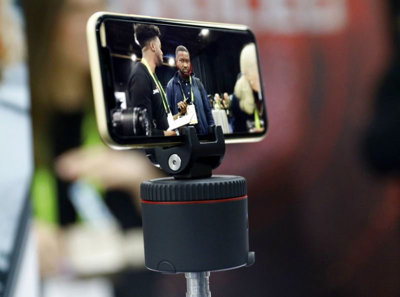 The Pivo is on display at the Pivo booth during CES Unveiled at CES International, Sunday, Jan. 6, 2019, in Las Vegas. The device and app allows your phone to move to follow faces or objects for photos and video, among other modes. (AP Photo/John Locher)