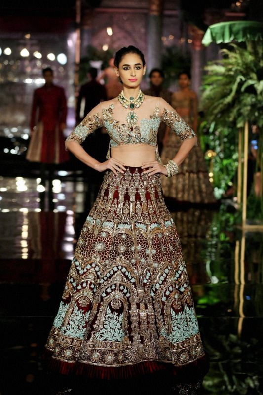A model wears a lehenga from Manish Malhotra's latest collection