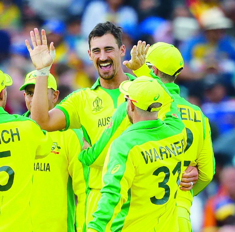 Australia's Mitchell Starc (left) celebrates taking the wicket of Sri Lanka's Kusal Mendis in their World Cup match at The Oval in London on Saturday. (Photo: AP)