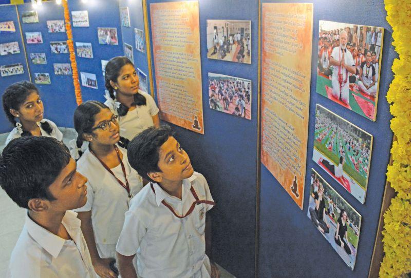 Students of Maharishi Vidya Mandir Senior Secondary School in Chennai take a look at a yoga themed photo  exhibition on their campus. (Photo: DC)