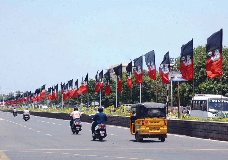 Flags of AIADMK fixed on medians in Chennai. (Photo: DC)