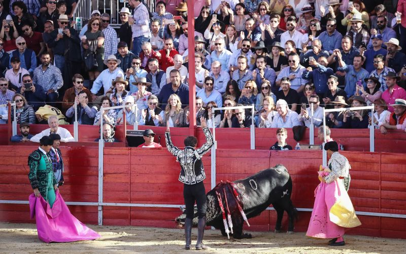 A matador celebrates (C) after killing a bull at a sold-out bullfight on April 8, 2018 in Tijuana, Mexico. Bullfighting is a 500-year-old tradition brought to the country by Spanish conquistadors. (Photo: AFP)