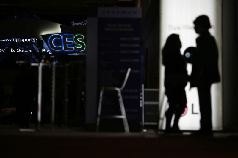 People walk around the Las Vegas Convention Center during preparations for CES International, Saturday, Jan. 5, 2019, in Las Vegas. The CES 2019 gadget show kicks off Sunday. (AP Photo/John Locher)