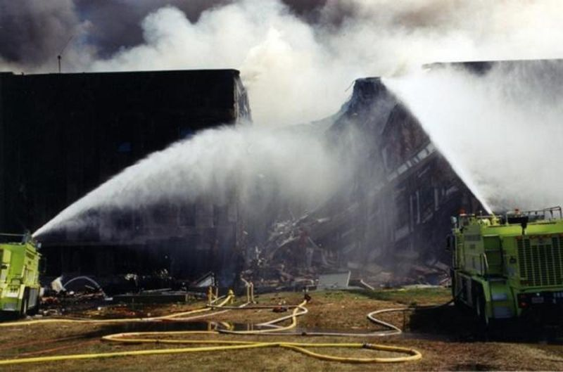 Firefighters douse the flames after the plane slammed into the iconic five-sided building housing the headquarters of the US defense department. (Photo: FBI)