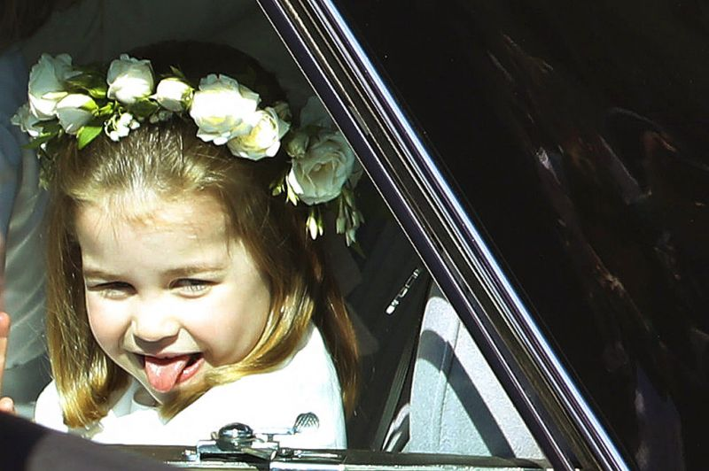 Much akin to what her royal uncle was famous for, Princess Charlotte sticks out her tongue as she rides in a car to the wedding ceremony of Prince Harry and Meghan Markle. (Photo: AP)