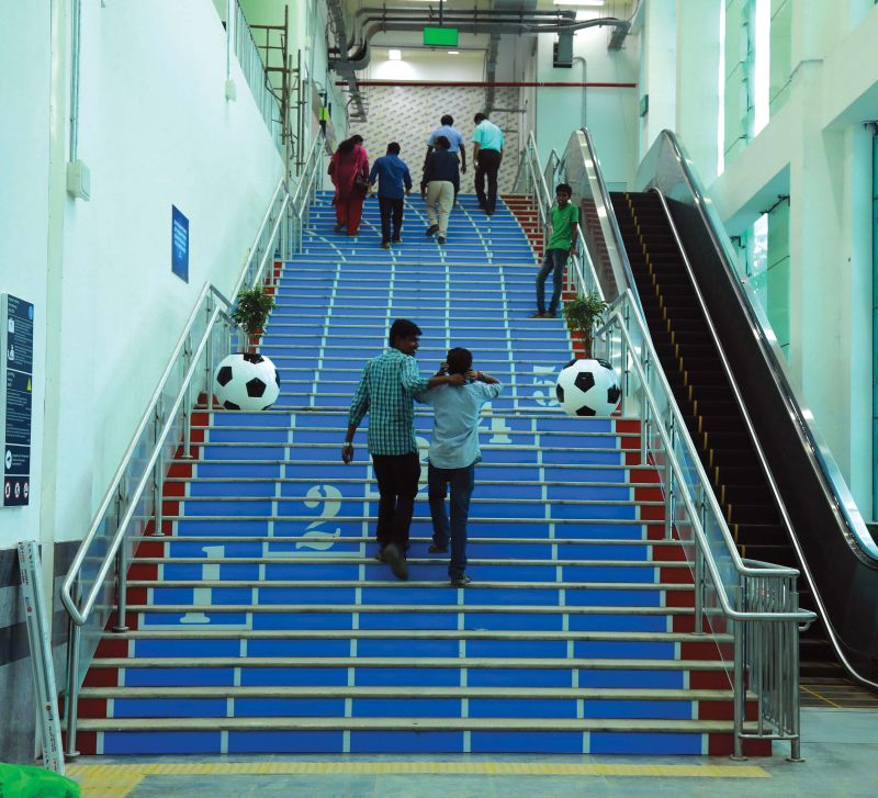 Staircase of JLN Stadium station set up on the synthetic track theme.