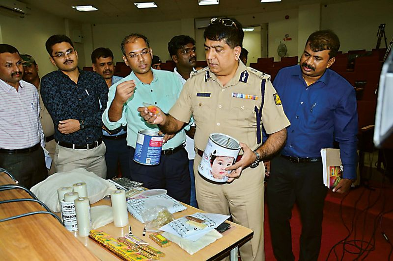 City Police Commissioner Bhaskar Rao shows drugs packed in milk powder boxes