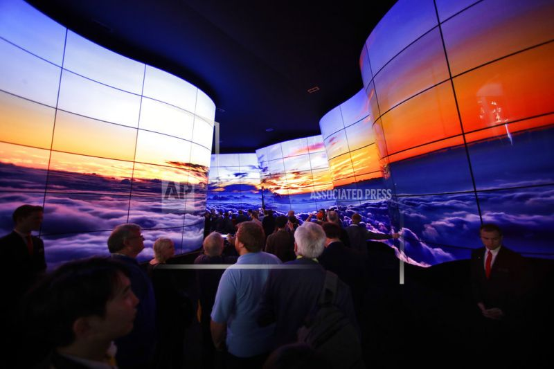 Attendees look at an installation built with LG OLED displays.