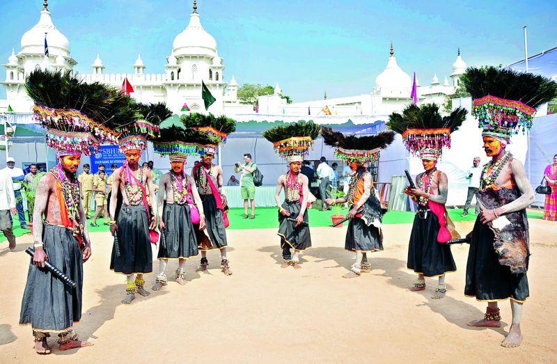 Folk artistes performing the Ghusadi dance form of Telangana