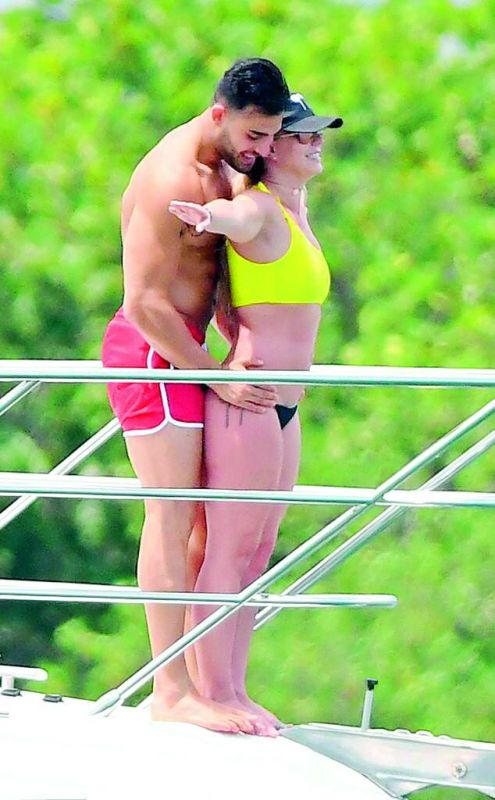 Britney Spears and her 25-year-old personal trainer beau Sam Asghari.