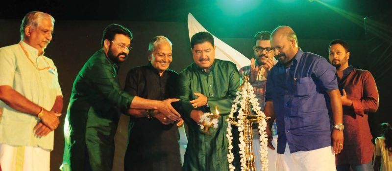 Actor Mohanlal, industrialist B.R. Shetty and Kalamandalam Gopi light the traditional lamp to start the birthday celebrations. Melam maestro Peruvanam Kuttan Marar, agriculture minister V.S. Sunil Kumar are also seen. (Photo: DC)