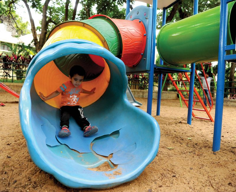 A damaged slide at a BBMP park on 18th Main Road in Koramangala on Monday. (Photo: DC)
