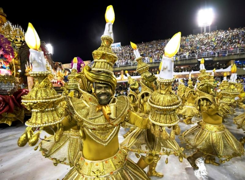 Members of the Viradouro school samba through the 700 meter Sambradrome in Rio's carnival: each school fields hundreds, if not thousands, of dancers, as well as floats and drummers. (Photo: AFP)