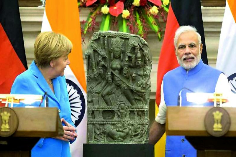 German Chancellor Angela Merkel returned a stone carving of Goddess Durga to India (bottom) The Amravati relief that was stolen in 2005
