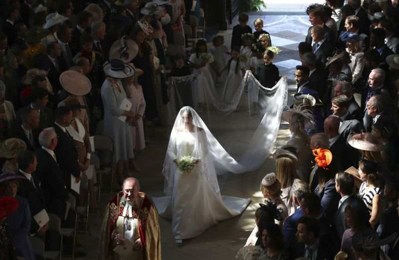 Meghan Markle walks down the aisle as she arrives for the wedding ceremony to Prince Harry at St. George's Chapel in Windsor Castle in Windsor.