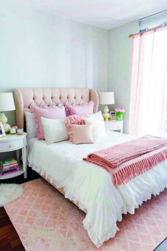 Millennial pink headboard brightens up your room.