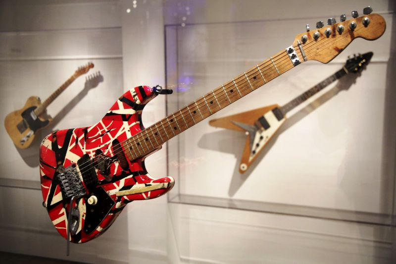 A guitar made and played by Eddie Van Halen of Van Halen is displayed at the exhibit. (Photo: AP)