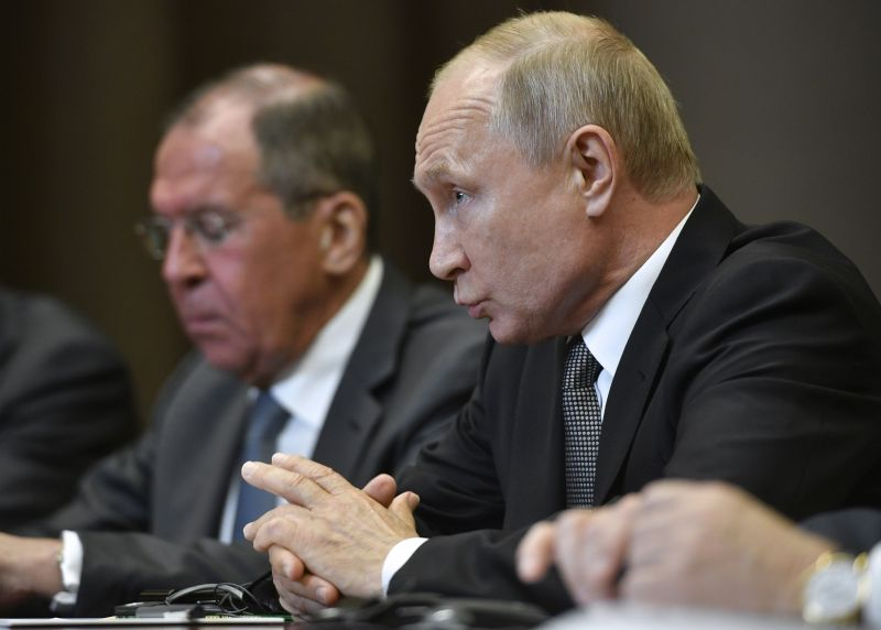 Russian President Vladimir Putin, right, speaks to U.S. Secretary of State Mike Pompeo, during their talks in the Black Sea resort city of Sochi, southern Russia, Tuesday, May 14, 2019. Pompeo arrived in Russia for talks that are expected to focus on an array of issues including arms control and Iran. Russian Foreign Minister Sergey Lavrov is on the left. (Alexander Nemenov/Pool Photo via AP)