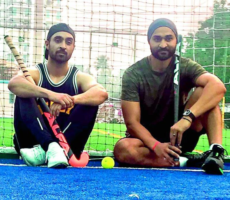 Diljit Dosanjh (left), who is playing the role of Sandeep Singh in the movie Soorma, poses with the real life  hockey champion Sandeep Singh (right).