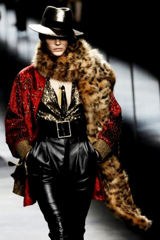 Saint Laurent topped many of its looks with shiny silky fedoras. (Photo: AFP)