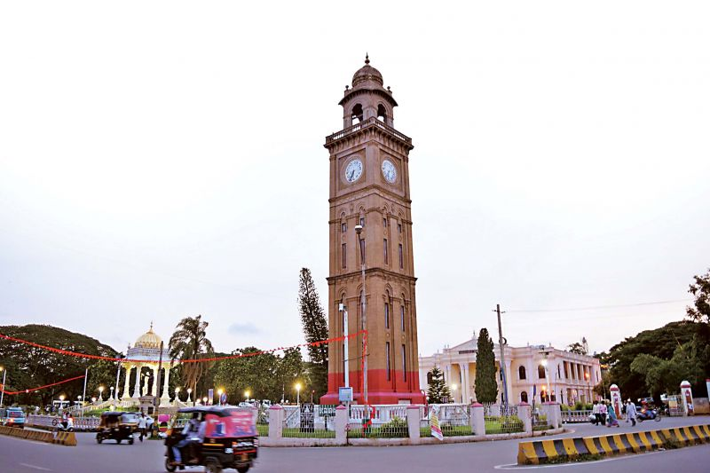 The iconic big clock tower near the famous Mysuru Palace is facing a threat of collapse unless the MCC authorities act swiftly. (Photo: DC)