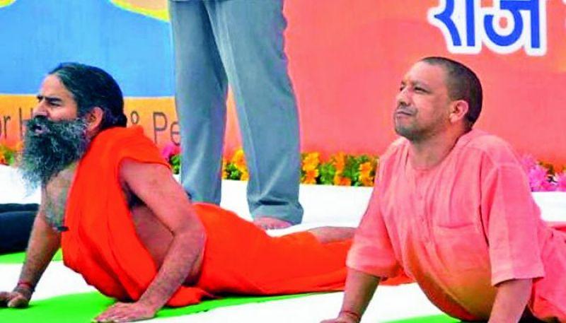 Yogi Adityanath does yoga with Baba Ramdev