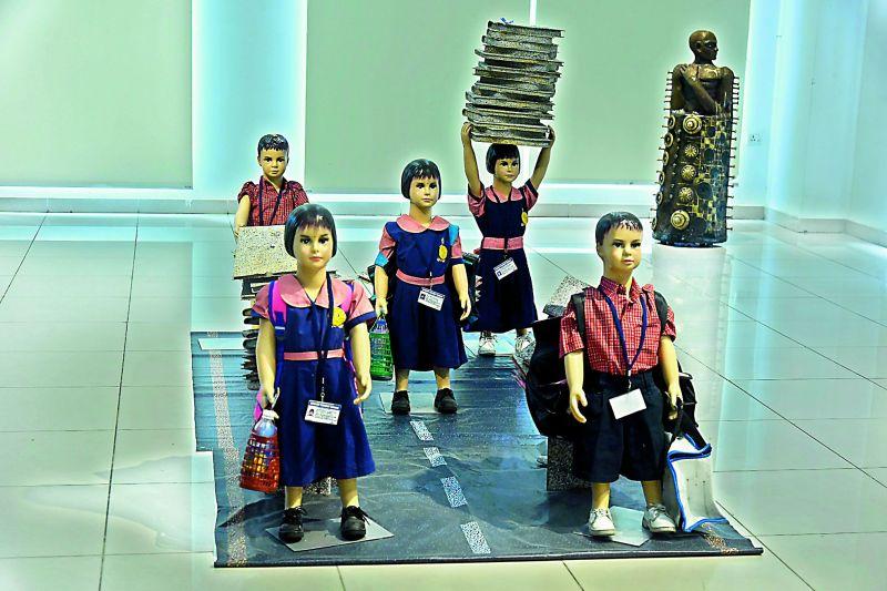 Tirumala Thirupathi's art installation about overburdening children with heavy books.