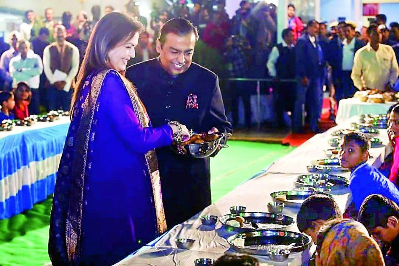 The Ambanis fed 5,100 orphans, homeless and differently-abled thrice a day in a ceremony called 'Anna Seva'. (Above) Nita and Mukesh Ambani serving the food