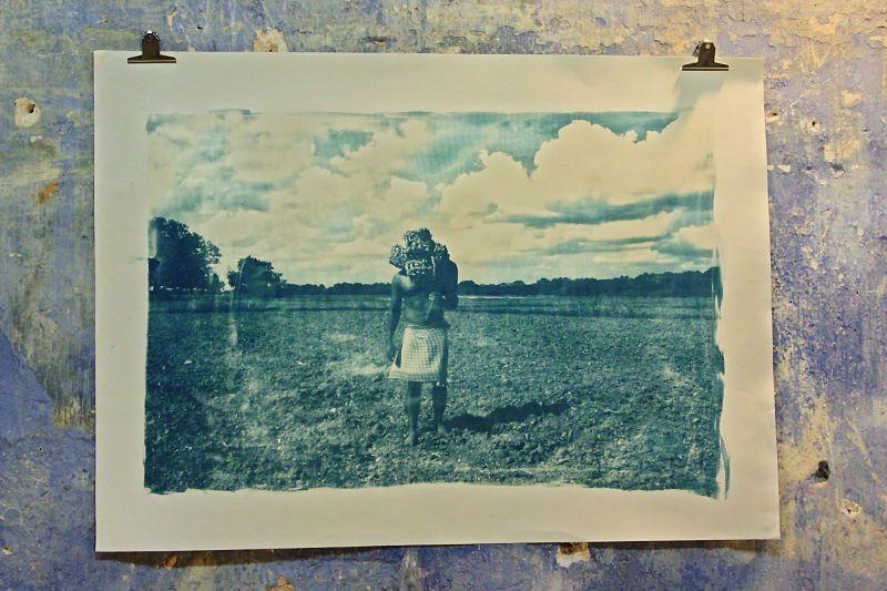 Cyanotype print depicting farmers