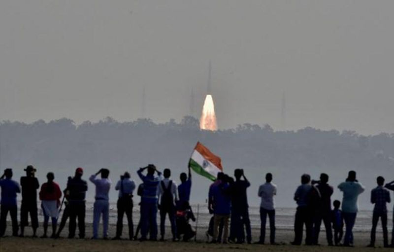 People watch as a rocket from ISRO takes off successfully to launch a record 104 satellites. (Photo: PTI)