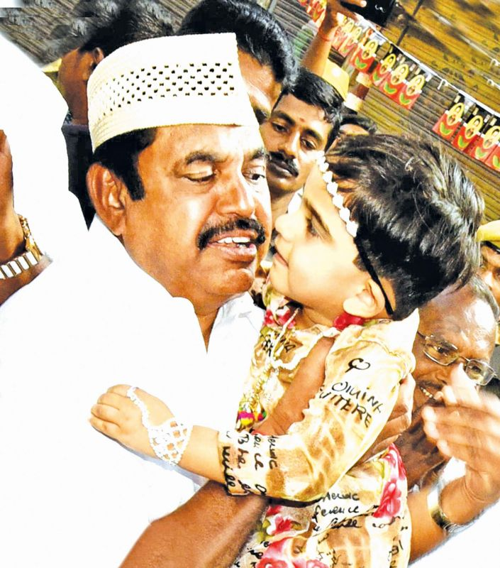 CM dons a Muslim cap and and pets a kid. (Photo: K. Senthil Nathan)
