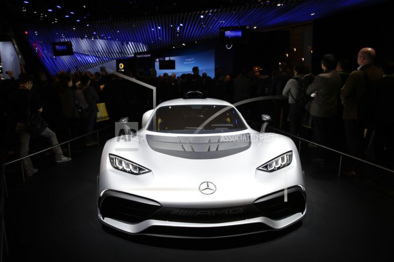 The Mercedes-AMG Project One plug-in hybrid supercar appears on display.