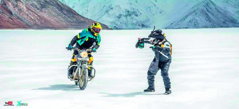 The team members having fun on the frozen Pangong Lake